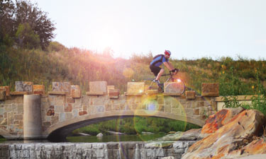 A cyclist in San Antonio takes advantage of a brand-new connecting trail across the San Antonio River. The Mission Reach project of the San Antonio River Authority includes 15 miles of new trails along the river.