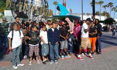 Los Angeles youth try new activites and broaden their circle of friends as part of the Watts Cluster Project.