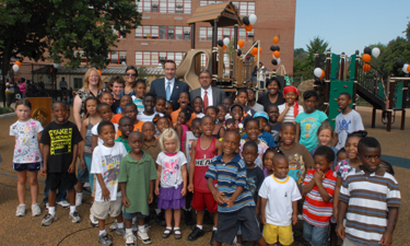 Mayor Gray (in blue tie) and D.C. Parks Director Jesús Aguirre (in red tie) announce a playground renovation program.