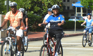 Mayor-President Holden (in blue) rides at the annual Mayor's Family Bike Ride through downtown Baton Rouge.