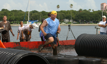 Harmon and other city staff compete against local youth in the St. Petersburg Mud Wars.
