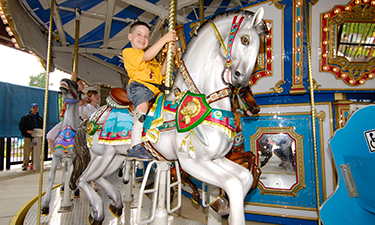 This accessible carousel at Clemyjontri Park in Virginia features chariots and a spinning tea cup that accommodate children in wheelchairs. Photo: Don Sweeney/Fairfax County Park Authority.