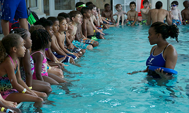 Children at the Carl E. Sanders Family YMCA at Buckhead, located in Atlanta, Georgia, participate in a recent World's Largest Swimming Lesson.