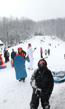 A young sledder at Chestnut Ridge Park and Campground enjoys the annual toboggan festival.