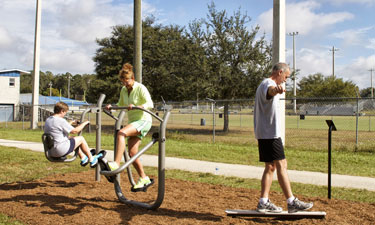 Visitors at the Jervey Gantt Recreational Complex Trail in Ocala, Florida, can work out using new fitness equipment designed by GameTime.