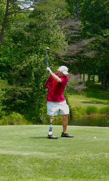 A golfer takes aim at the Fairfax County Park Authority's Combo Classic in Virginia, an annual tournament that pairs able-bodied golfers with those who have physical or cognitive disabilities.