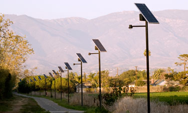Solar lights line the edge of a trail in Visalia, California. During the day, panels store energy from the sun, which powers the LED lights at night.