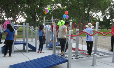 Residents explore the new senior playground at Carbide Park in LaMarque, Texas. The special equipment is intended to improve seniors' agility and coordination through games and exercises.