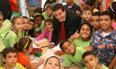 Mayor Carlos Hernandez visits with children in his community. Hernandez spearheaded specialized programs for at-risk youth that address all aspects of healthy living.