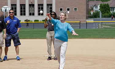 Illinois Rep. Elaine Nekritz (IL-57) throws out the first pitch at Buffalo Grove's new baseball field at Kilmer Park.