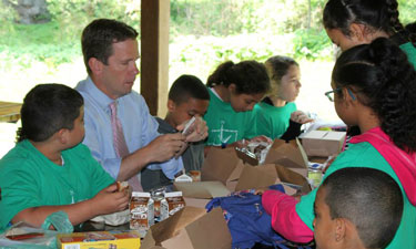 Rep. Bob Dold (R-IL-10) has lunch with children at Waukegan Park District during  a 2015 Park Champion event to check out its Summer Food Service Program.