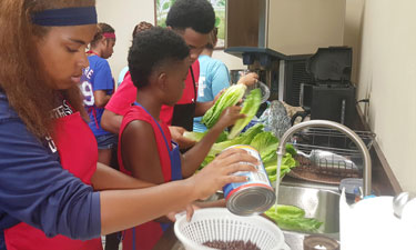 Super Chefs prepare a meal at the Grand Prairie, Texas, Parks, Arts and Recreation Department, demonstrating what they learned throughout the summer.