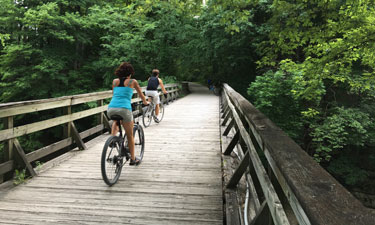 Cyclists on a portion of the MKT Trail in Columbia, Missouri.