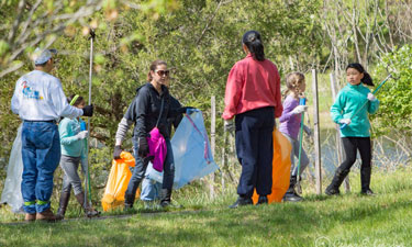 Girl Scout Troop 3475 leads a community cleanup at Beaverdam Reservoir Park in the Brambleton Community in Loudoun County, Virginia.